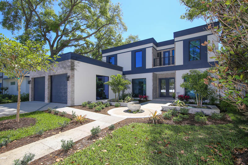 Discover The How Contemporary And Industrial Design Complement Each Other  In This Custom Home Designed And Constructed By Green Life Luxury Homes LLC.